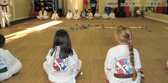 Student playing games with Legacy Martial Arts Training Camp
