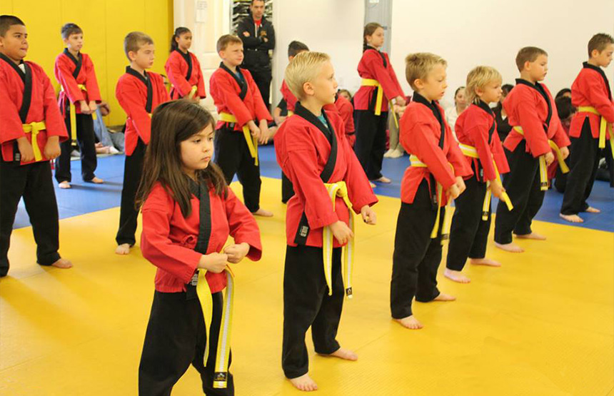 children holding the karate stance