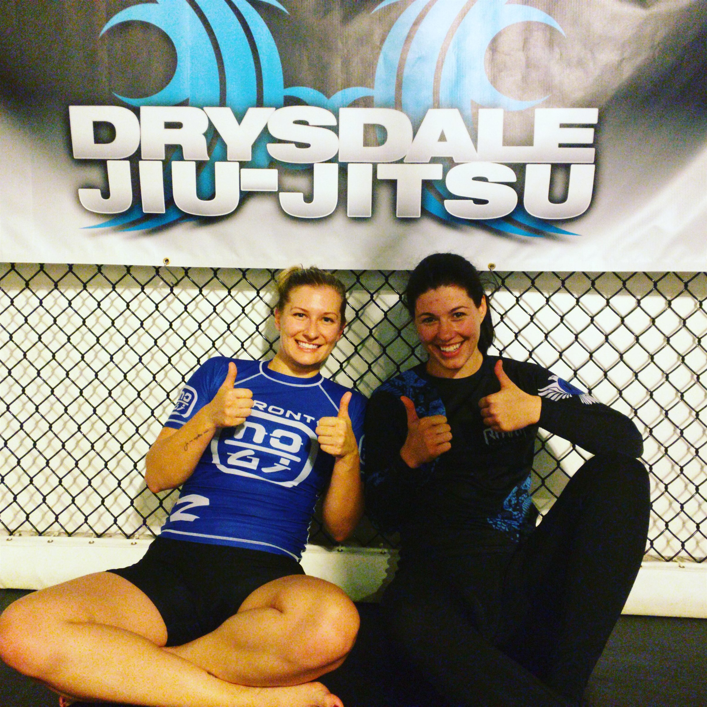 ladies give thumbs up to bjj