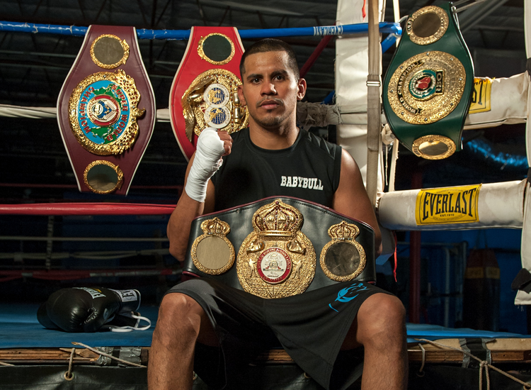 Photo of Juan Diaz decorated with multiple championship belts