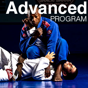 2 men grappling in advanced class