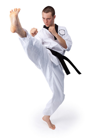 man doing jumping front kick