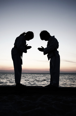 youth tkd students bowing to each other>