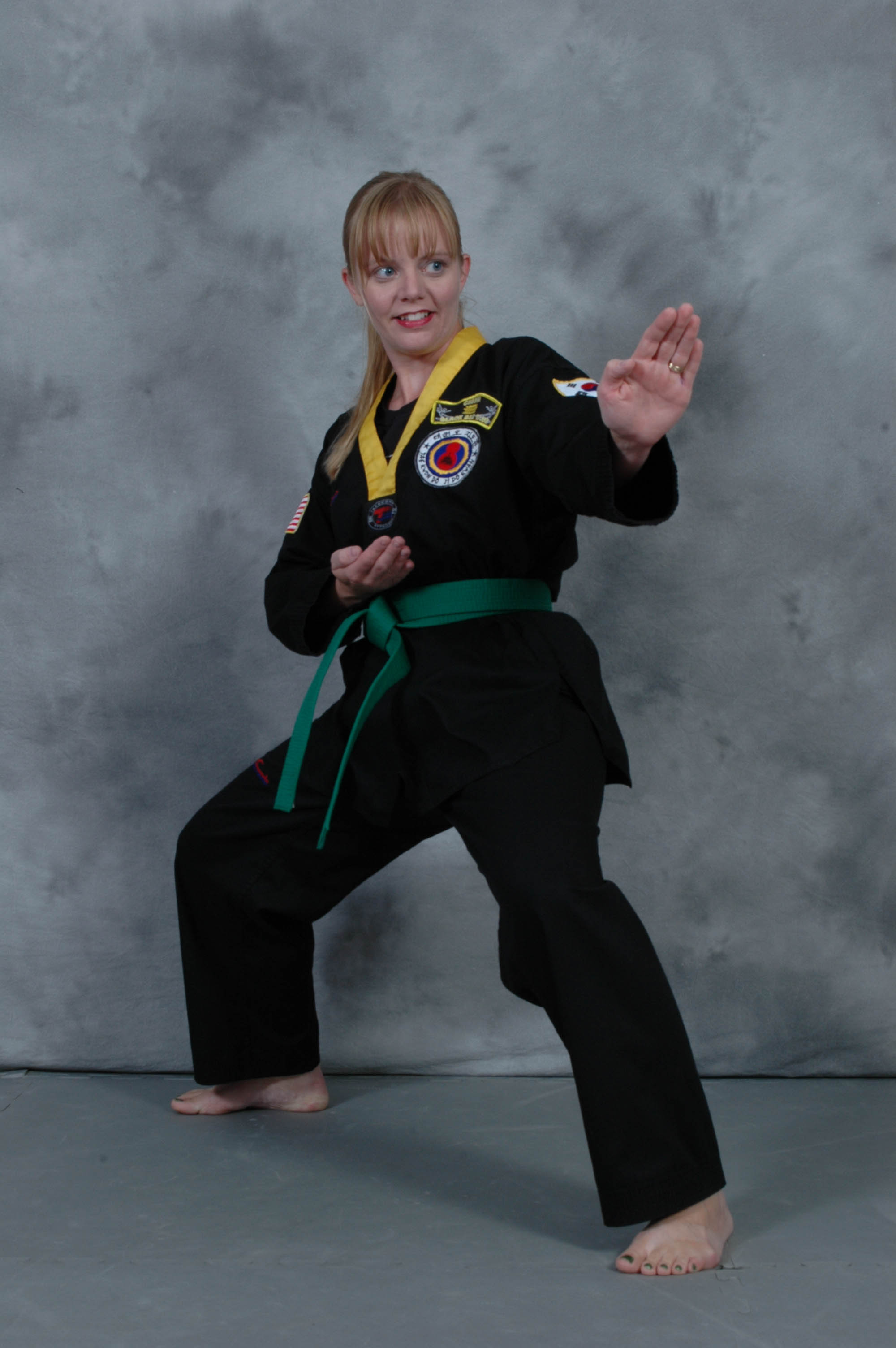 young lady preforming martial arts stance