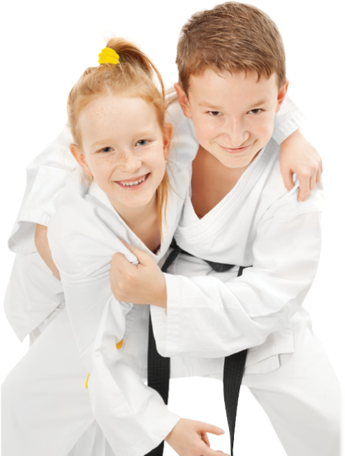 little girl and boy embracing in martial arts class