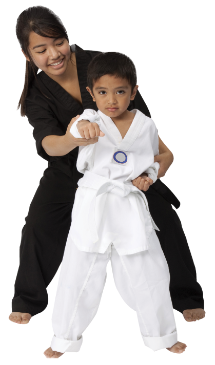 little boy with martial arts instructor