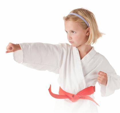 little girl doing martial arts punch