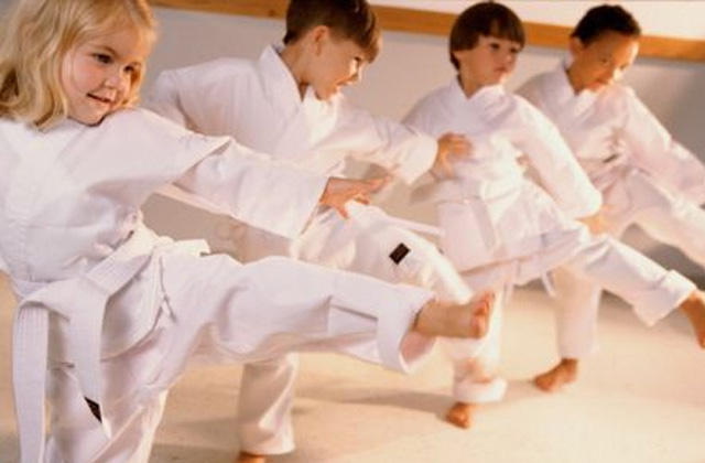kids kicking in martial arts class