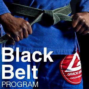 man tying his black belt