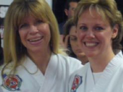 women smiling at a taekwondo event