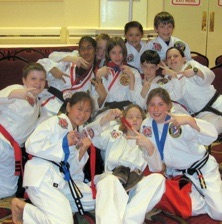 group of taekwondo students with medals